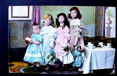 4_girls_having_tea_with_dolls